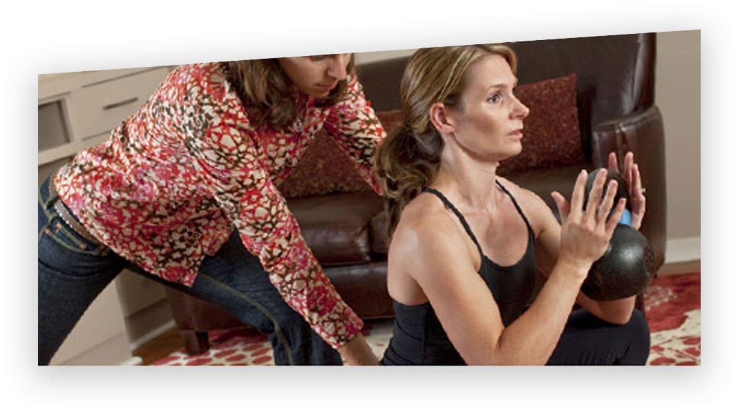 Julia Caulder instructing female client.